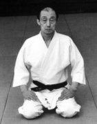 Kenji Tomiki.